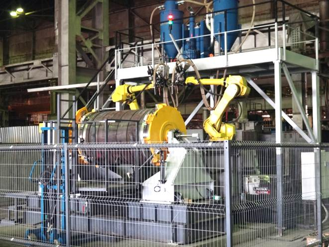 Robotic cell for welding ball valves